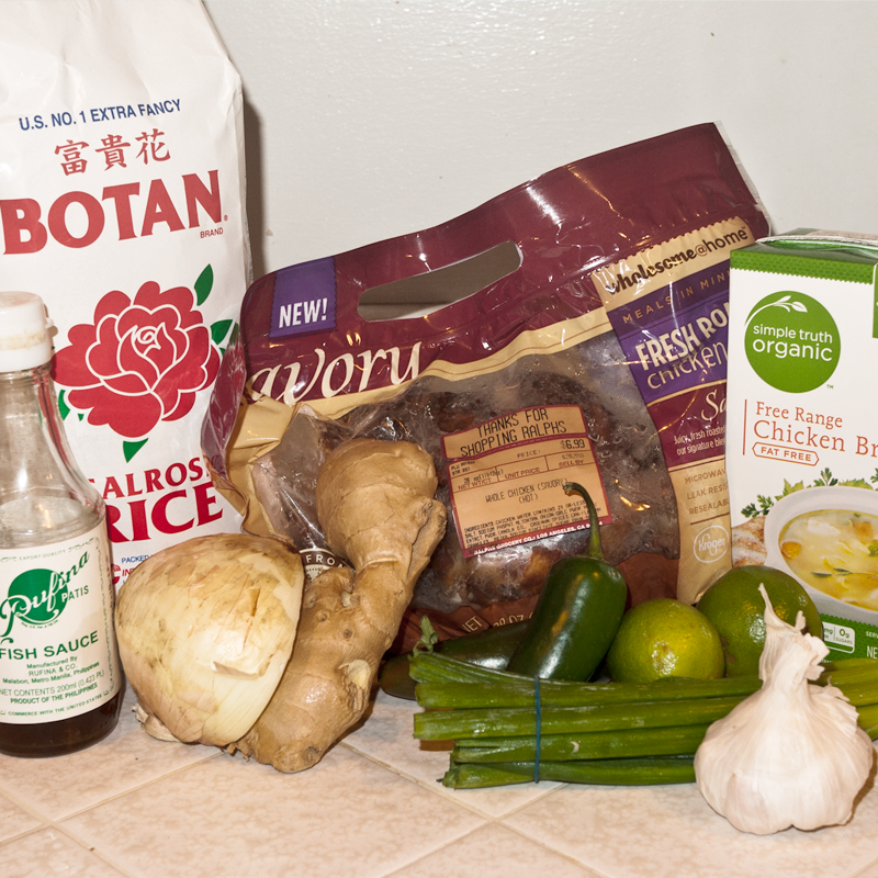 The ingredients are pretty simple - rice, chicken, chicken broth, garlic, scallions, limes, ginger, jalapenos, onions, patis.