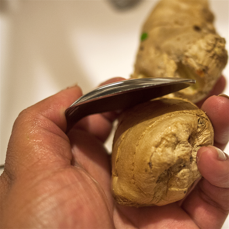 Tiny kitchen tip: you can peel ginger easliy by scraping off the skin with a spoon. When you use a knife to remove the thin skin, chances are you're removing some of the actual ginger unnecessarily. Use a spoon!