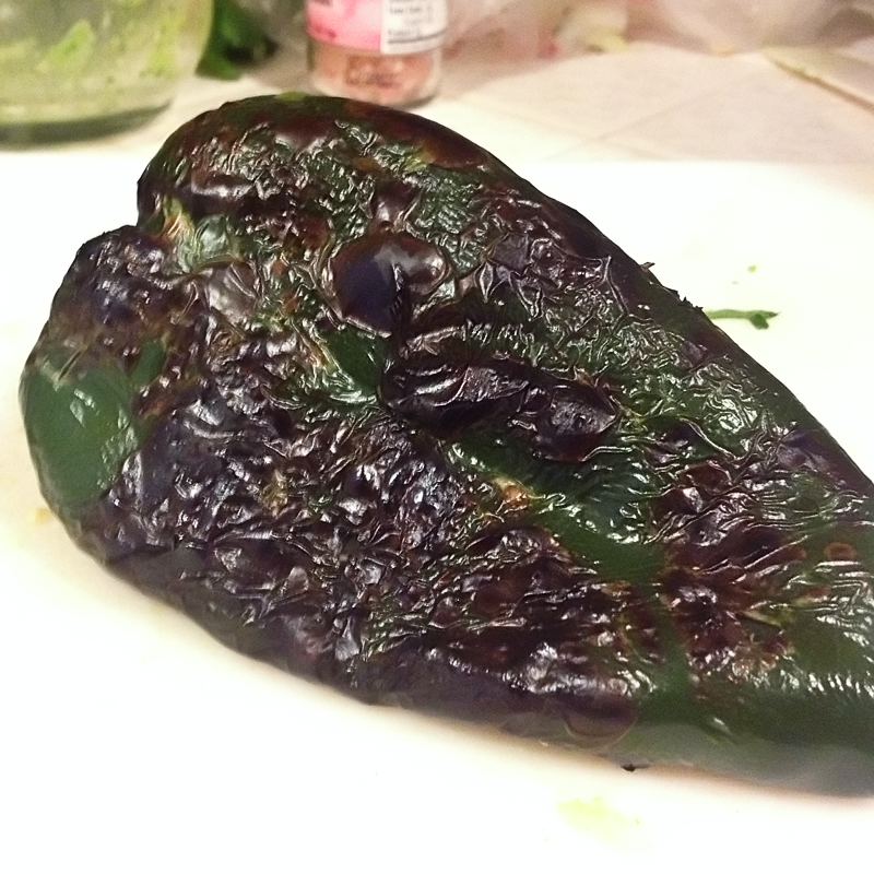I roasted the poblano over an open flame on my stovetop. You could do it on a grill... and I guess you could do it in a pan if you don't have a gas stove. Or you could do it in the broiler. Basically, char the skin, that gives the flavor.