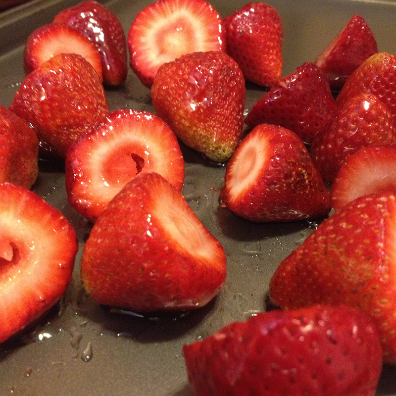 Fresh strawberries, coated with light corn syrup, ready to be roasted.