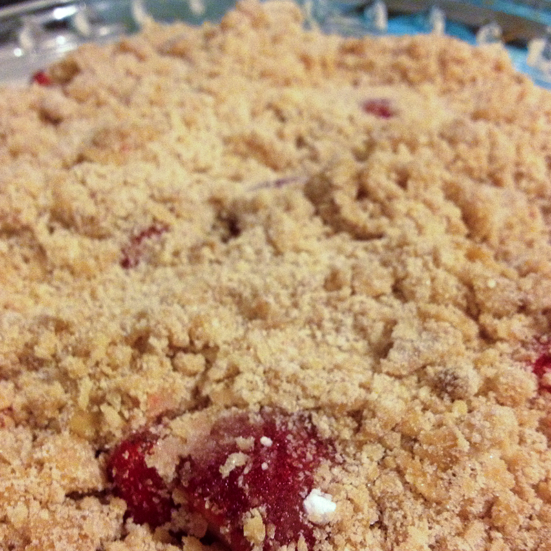Covered with the crumble mixture, ready to be drizzled in butter and popped in the oven.