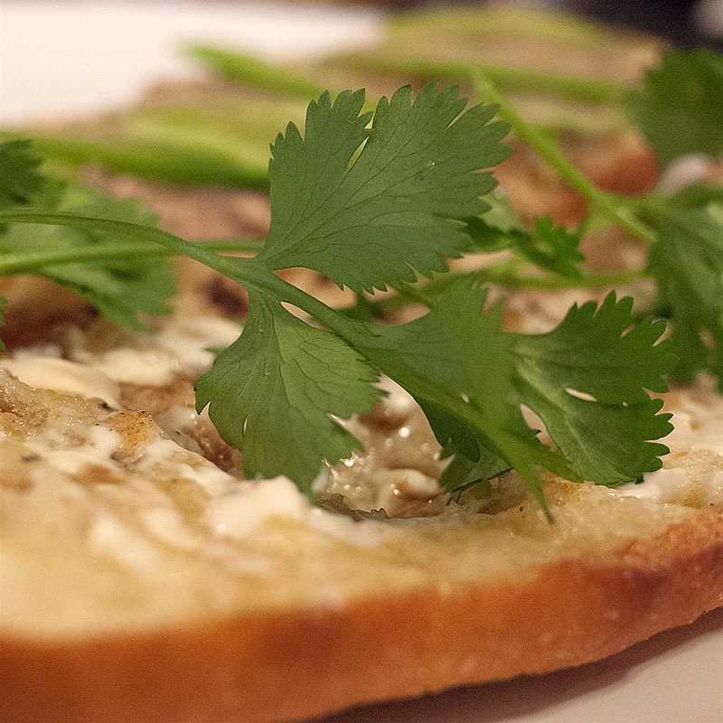 Add cilantro to the mayo/maggi side of the bread. I like to leave some stems in as well.