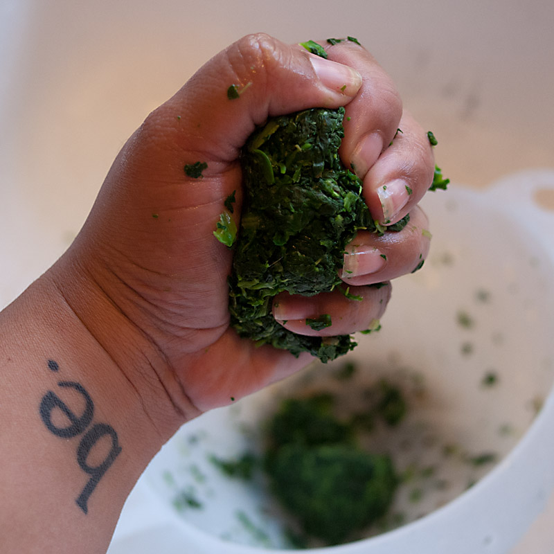 You have to get as much water out of the spinach as you can. Squeeze, and squeeze again. You like my tattoo? Find out more about it here.