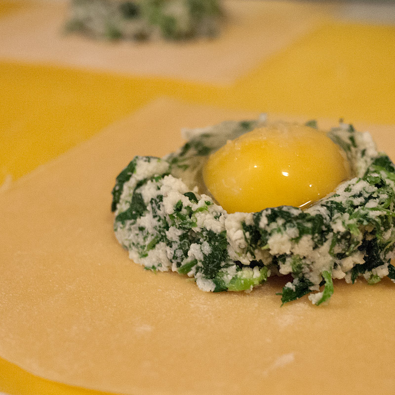 Create a little well in the spinach mixture with the back of a spoon. After cracking your egg into a small bowl, carefully place the yolk into the mound with a little bit of additional egg white.
