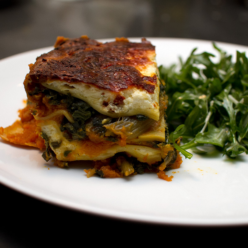pumpkin and swiss chard lasagna with homemade saffron noodles and truffled ricotta