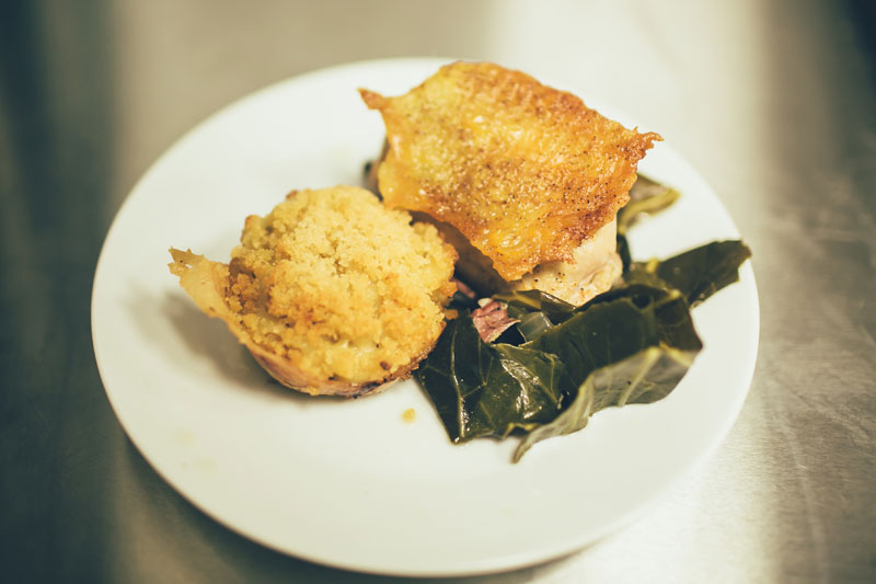 Third course - chicken thighs brined, then sous-vide, crispy chicken skin, smoked turkey collards, cajun cheddar mac and cheese muffins, wrapped in prosciutto. photo credit: Chantal Pasag | Pasagraphy